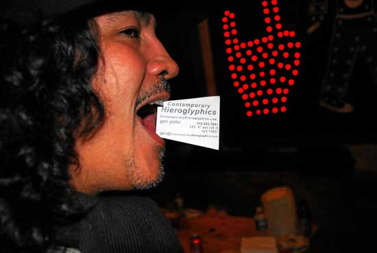 Doze Green with ContemporaryHieroglyphics card in his mouth